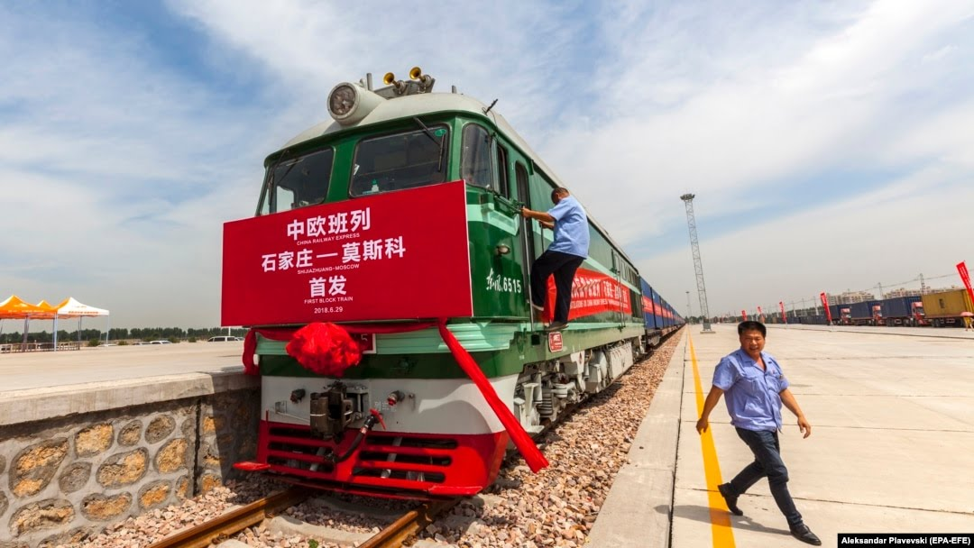 Railway workers prepare the first block train for departure from Shijiazhuang, China, to Moscow in the port in Hebei Province in June 2018, just one part of the sprawling Belt and Road Initiative.